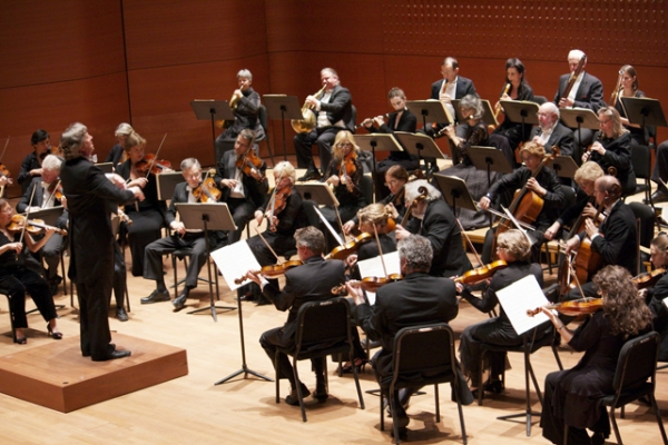 Orchestra following Conductor